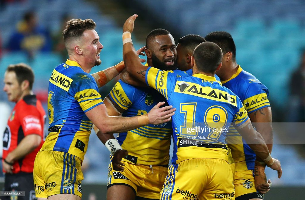 Semi Radradra of the Eels is congratulated after scoring a try during the round 12 NRL match between the South Sydney Rabbitohs and the Parramatta Eels at ANZ Stadium on May 26, 2017 in Sydney, Australia.
