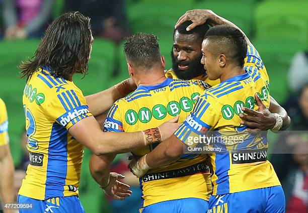 Semi Radradra of the Eels is congratulated by team mates after scoring a try during the round 14 NRL match between the Melbourne Storm and the...