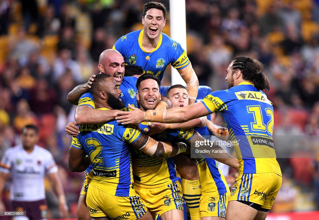 Semi Radradra of the Eels is congratulated by team mates after scoring a try during the round 25 NRL match between the Brisbane Broncos and the Parramatta Eels at Suncorp Stadium on August 24, 2017 in Brisbane, Australia.