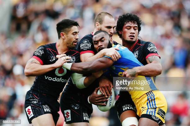 Semi Radradra of the Eels is tackled by Shaun Johnson Simon Mannering and James Gavet of the Warriors during the round six NRL match between the New...