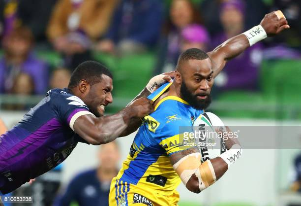 Semi Radradra of the Eels is tackled by Suliasi Vunivalu of the Storm and he is sent to the sin bin during the round 18 NRL match between the...