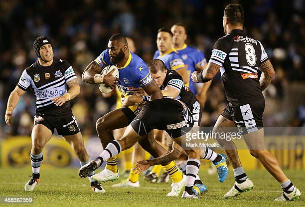Semi Radradra of the Eels is tackled during the round 17 NRL match between the Cronulla Sharks and the Parramatta Eels at Southern Cross Group...