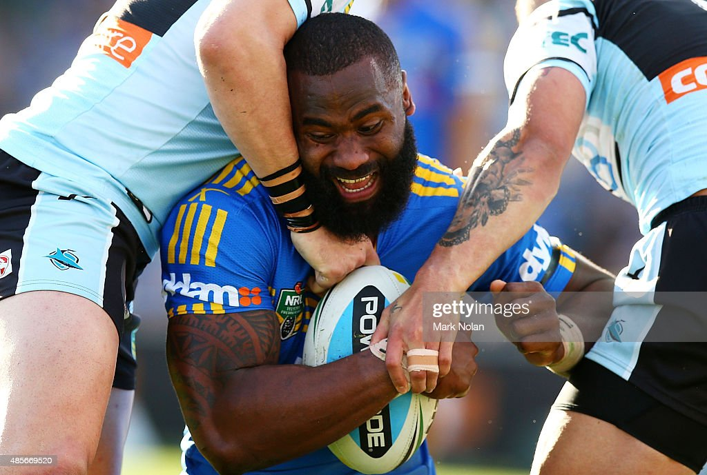 Semi Radradra of the Eels is tackled during the round 25 NRL match between the Parramatta Eels and the Cronulla Sharks at Pirtek Stadium on August 29, 2015 in Sydney, Australia.