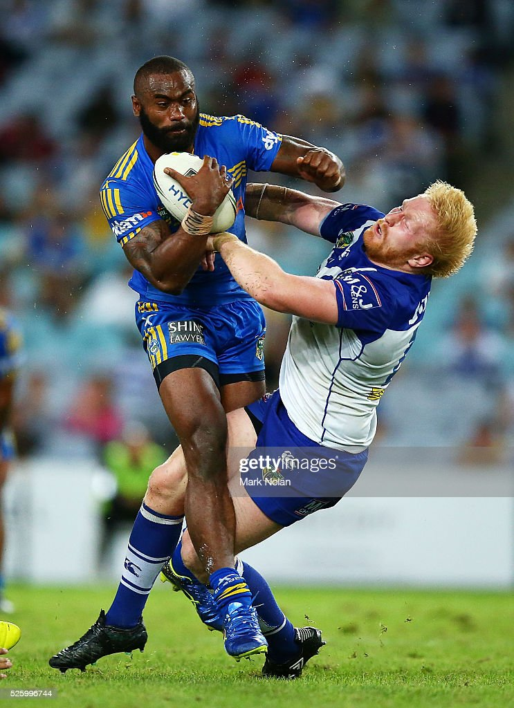 Semi Radradra of the Eels runs over James Graham of the Bulldogs during the round nine NRL match between the Parramatta Eels and the Canterbury Bulldogs at ANZ Stadium on April 29, 2016 in Sydney, Australia.