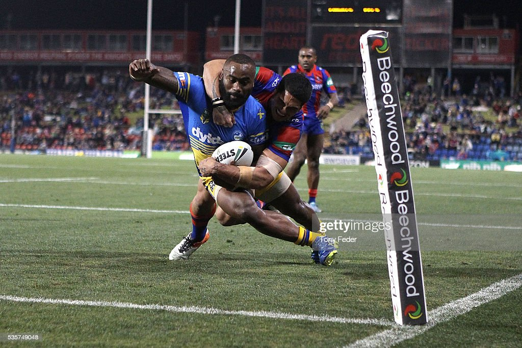 Semi Radradra of the Eels scores a try during the round 12 NRL match between the Newcastle Knights and the Parramatta Eels at Hunter Stadium on May 30, 2016 in Newcastle, Australia.