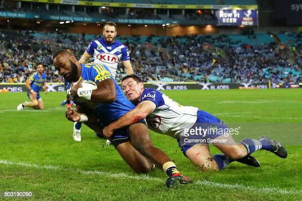 Semi Radradra of the Eels scores a try during the round 17 NRL match between the Parramatta Eels and the Canterbury Bulldogs at ANZ Stadium on June...