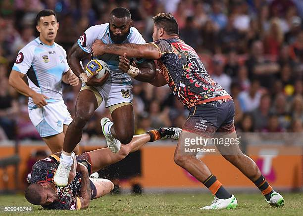 Semi Radradra of the World All Stars takes on the defence during the NRL match between the Indigenous AllStars and the World AllStars at Suncorp...