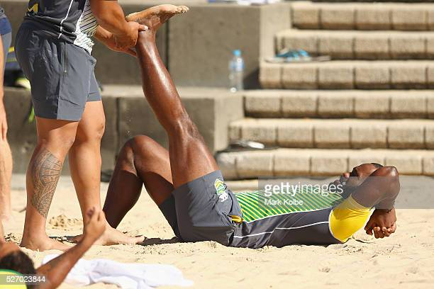 Semi Radradra stretches during the Australia Kangaroos Test team recovery session at Coogee Beach on May 2 2016 in Sydney Australia