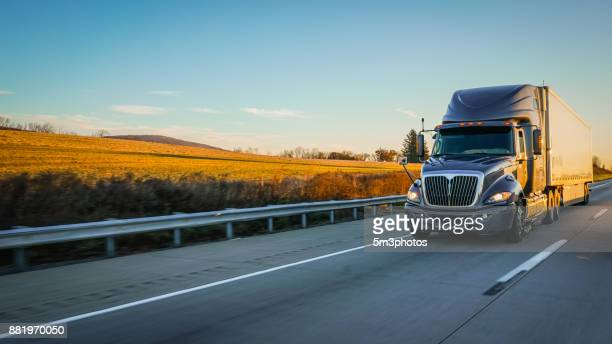 semi truck 18 wheeler on highway copy space - trucking stock pictures, royalty-free photos & images