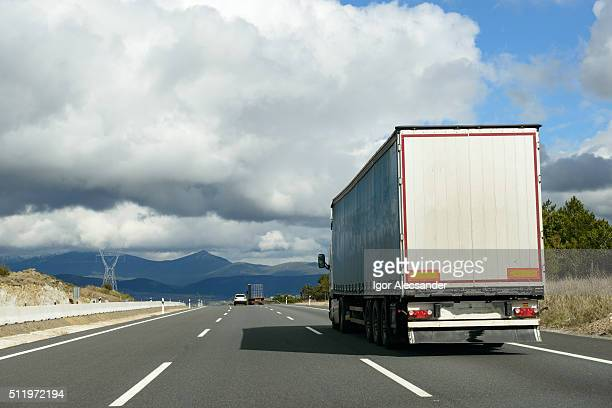 Semi truck down the Autovía A-6 highway to Madrid Capital, Avila Province, Spain