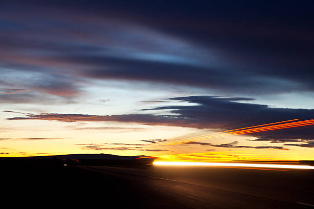 Semi Truck Lights Streaking By On Highway At Sunset Wall Art