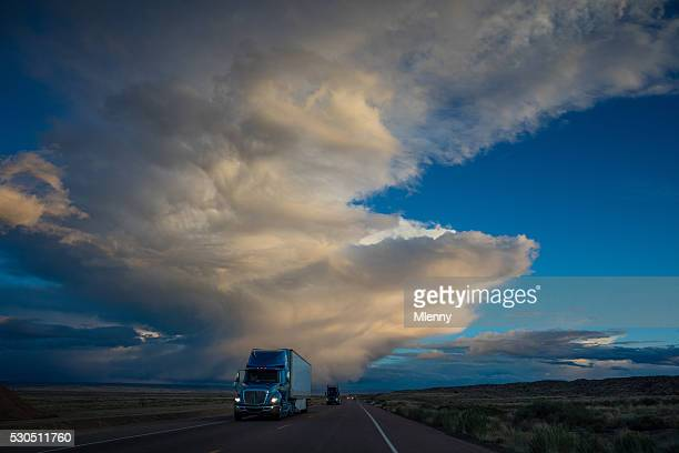 Semi Truck on American Highway Dramtic Twilight Sky