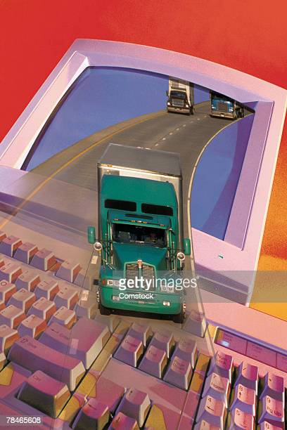 Semi truck on highway coming out of computer monitor