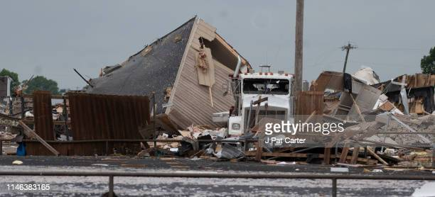 A semi truck sits among the rubble after a tornado struck the American Budget Value Inn May 26 2019 in El Reno Oklahoma At least two people were...