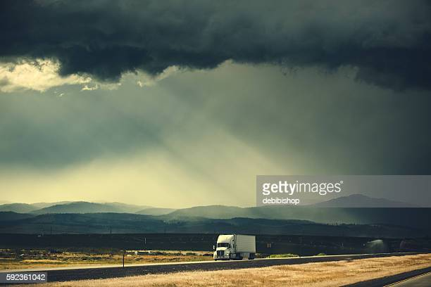 Semi Truck Traveling Lonely Highway Under Storm Clouds