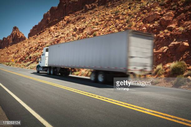 Semi Trucking Traveling Along Highway in Western States USA