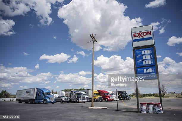 Semi trucks are parked behind a roadside Exxon station outside Aurora New Mexico US on Tuesday July 26 2016 Exxon Mobil Corp is scheduled to release...
