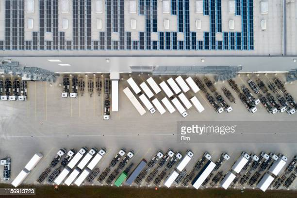 semi trucks at warehouse, aerial view - loading dock stock pictures, royalty-free photos & images