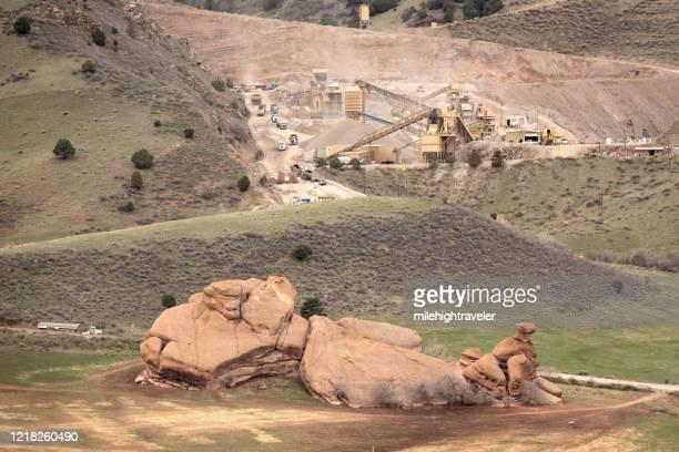 semi trucks line up open pit gravel mine red rocks morrison quarry colorado - milehightraveler stock pictures, royalty-free photos & images