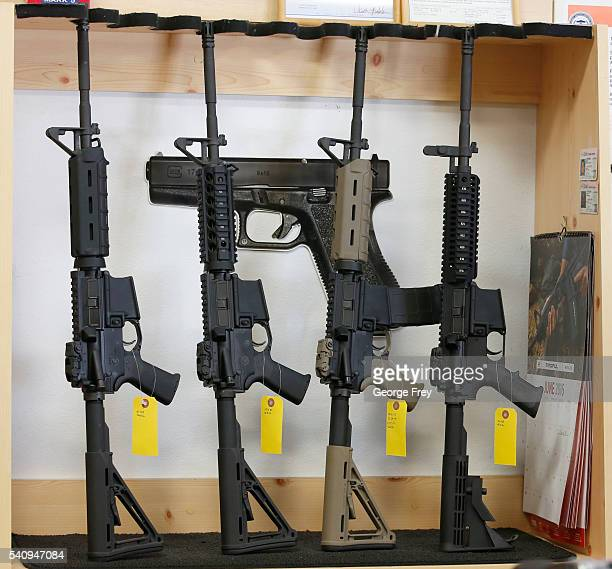 Semi-automatic guns are on display for sale at Action Target on June 17, 2016 in Springville, Utah. Semi-automatics are in the news again after the...