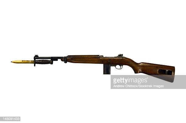semi-automatic m1 carbine, a standard firearm for the u.s. military in the world war ii era. - bayonet stock pictures, royalty-free photos & images