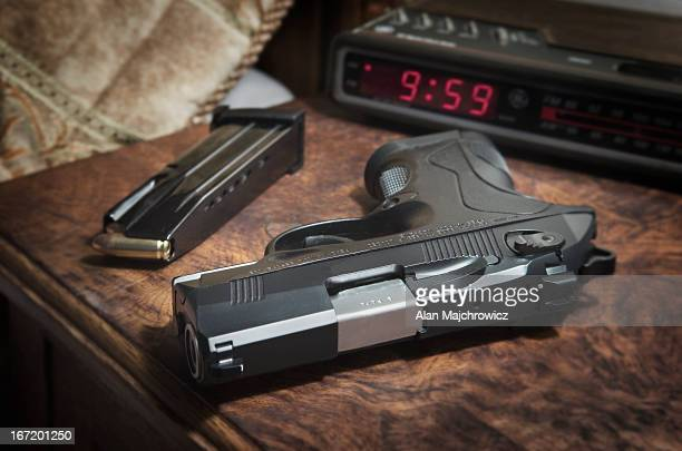 Semi-automatic pistol on bedside nighstand