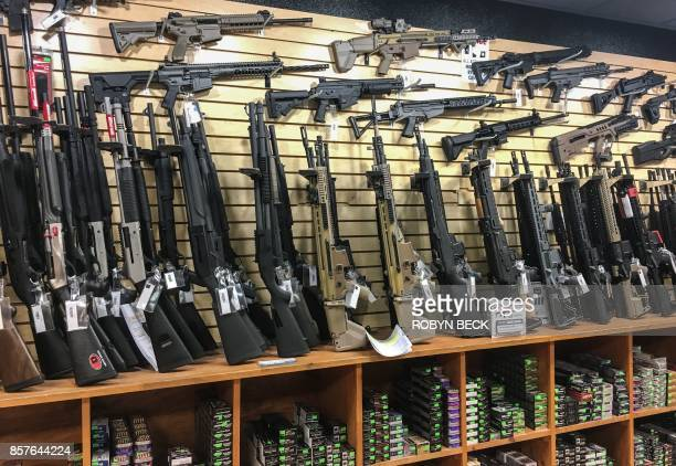 Semiautomatic rifles are seen for sale in a gun shop in Las Vegas Nevada on October 4 2017 Mass killer Stephen Paddock used semiautomatic weapons...