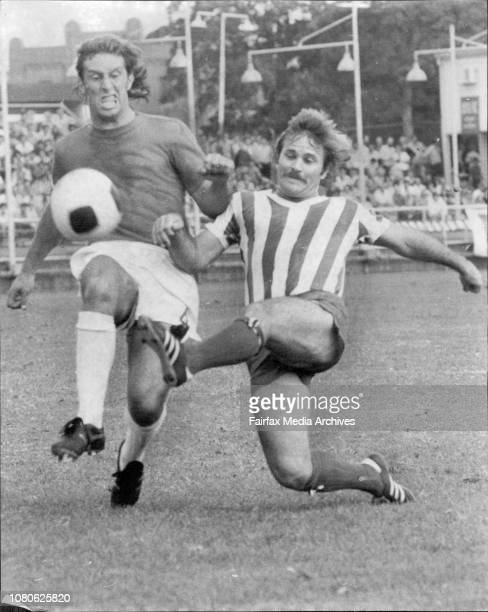 Semifinal Ampol Cup at Wentworth Park.St George Budspest Vs Pan Hellenic.St George defender Paul Coton and Pan Hellenic striker Gary Manuel show the...