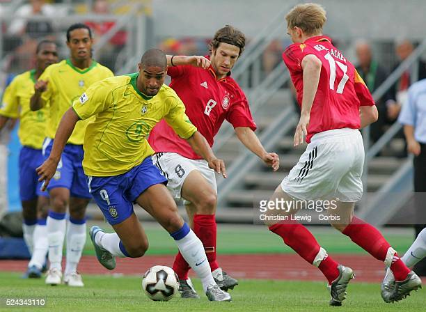 SemiFinals of the 2005 FIFA Confederations Cup Germany vs Brazil Brazil won 32 Adriano Torsten Frings and Per Mertesacker