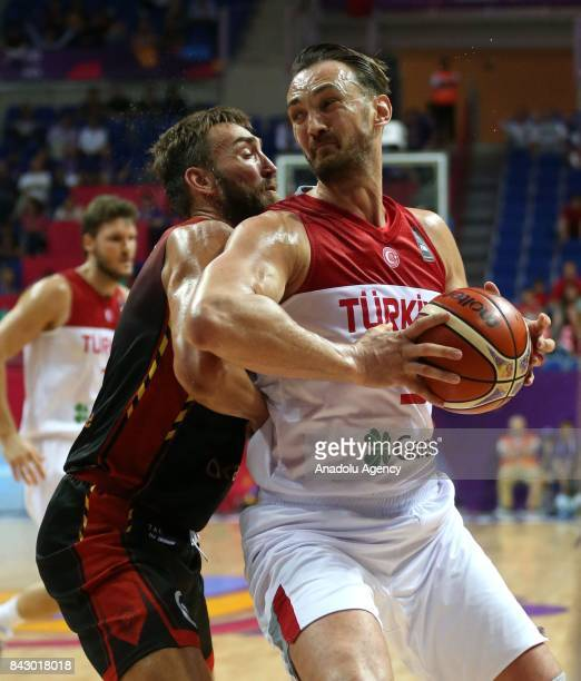 Semih Erden of Turkey in action against Axel Hervelle of Belgium during the FIBA Eurobasket 2017 Group D Men's basketball match between Turkey and...