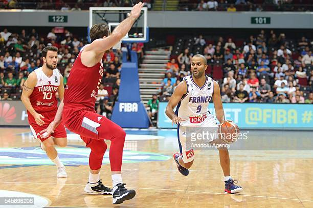 Semih Erden of Turkey in action against Tony Parker of France during the 2016 FIBA Olympic Qualifying tournament semi final match between France and...