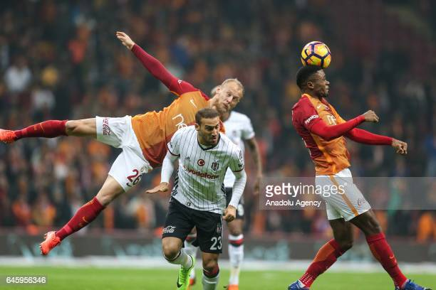Semih Kaya and Bruma of Galatasaray in action against Cenk Tosun of Besiktas during the Turkish Spor Toto Super Lig match between Galatasaray and...
