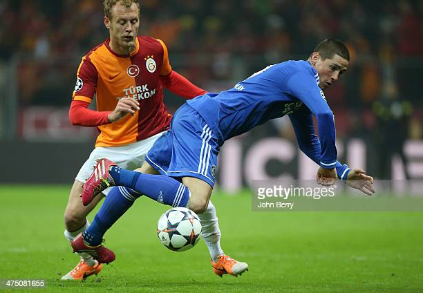 Semih Kaya of Galatasaray and Fernando Torres of Chelsea in action during the UEFA Champions League round of 16 between Galatasaray AS and Chelsea FC...