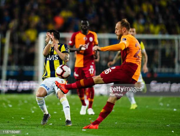 Semih Kaya of Galatasaray clearing the ball in front of Tolga Cigerci of Fenerbache during the Turkish Super Lig match between Fenerbache and...