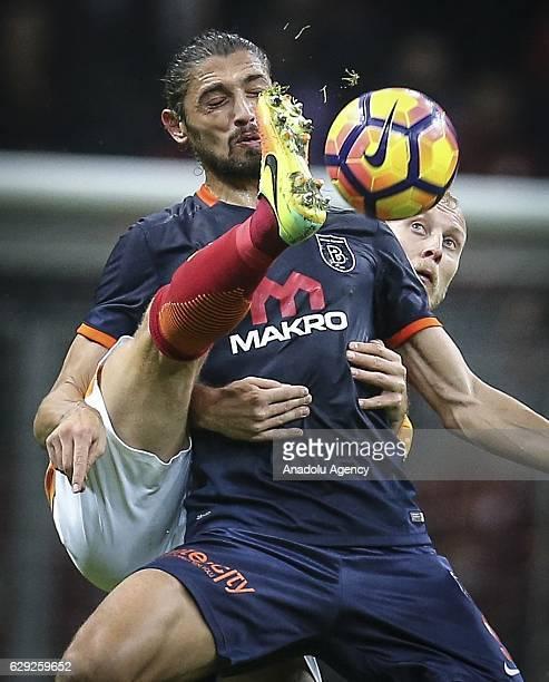Semih Kaya of Galatasaray in action against Mehmet Batdal of Medipol Basaksehir during the Turkish Spor Toto Super League soccer match between...