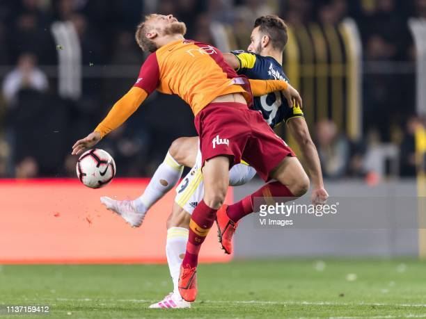 Semih Kaya of Galatasaray SK Roberto Rillo of Fenerbahce SK during the Turkish Spor Toto Super Lig football match between Fenerbahce AS and...