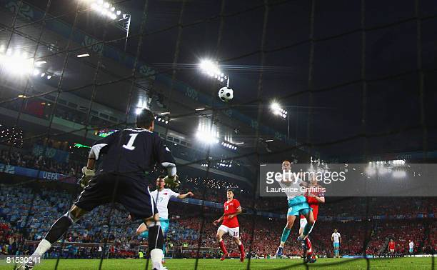 Semih Senturk of Turkey headers and scores his teams first goal as goalkeeper Diego Benaglio of Switzerland attempts the save during the UEFA EURO...