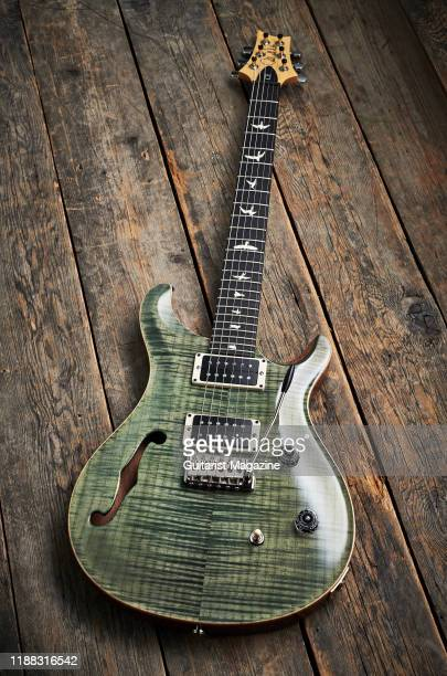 Semihollow electric guitar with a Trampas Green finish taken on March 26 2019