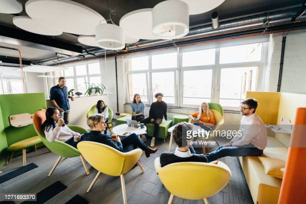 seminar between team in modern office - diversity stock pictures, royalty-free photos & images