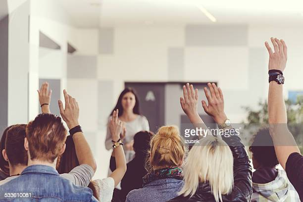 seminar for students - arms raised stock pictures, royalty-free photos & images