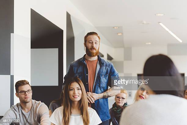 Seminar for students, redhair bearded man asking question