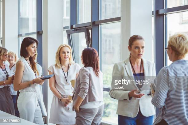 seminar for woman, women discussing during coffee break - event stock pictures, royalty-free photos & images
