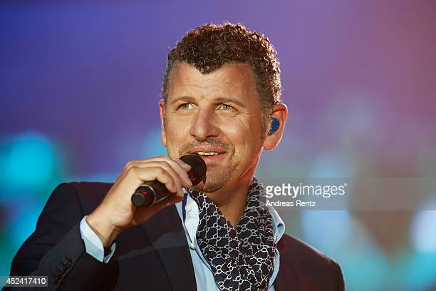 Semino Rossi performs live on stage during the Andrea Berg Open Air festival 'Heimspiel' at mechatronik Arena on July 19 2014 in Grossaspach Germany