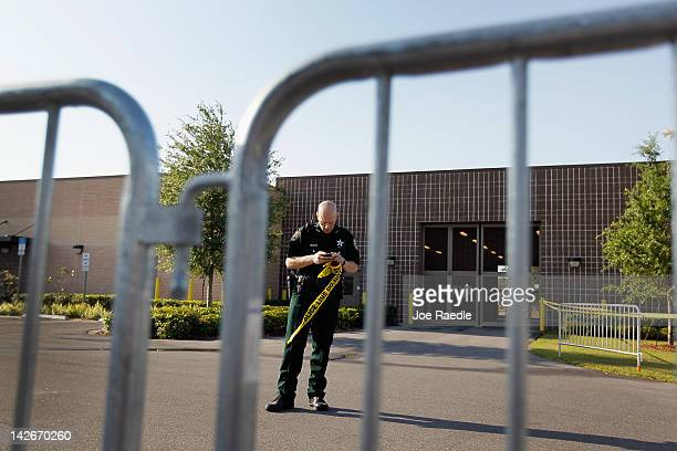 Seminole County Sheriff officer helps prepare the Seminole County Jail by placing barriers and crime scene tape around the entrance of the intake...
