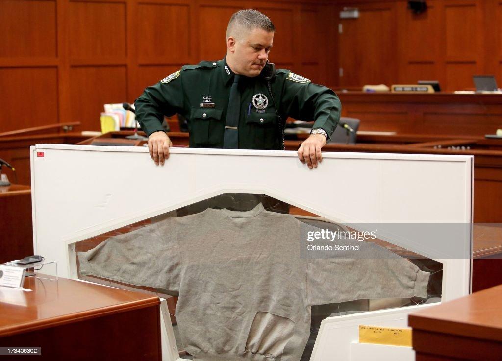 A Seminole County Sheriff's deputy carries Trayvon Martin's