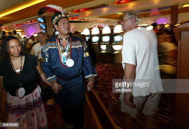 Seminole Indian Herbert Jim and his wife April Jim walk through the casino May 11 2004 during the grand opening for the Seminole Hard Rock Hotel and...