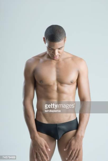 semi-nude african man with head down - a petto nudo foto e immagini stock