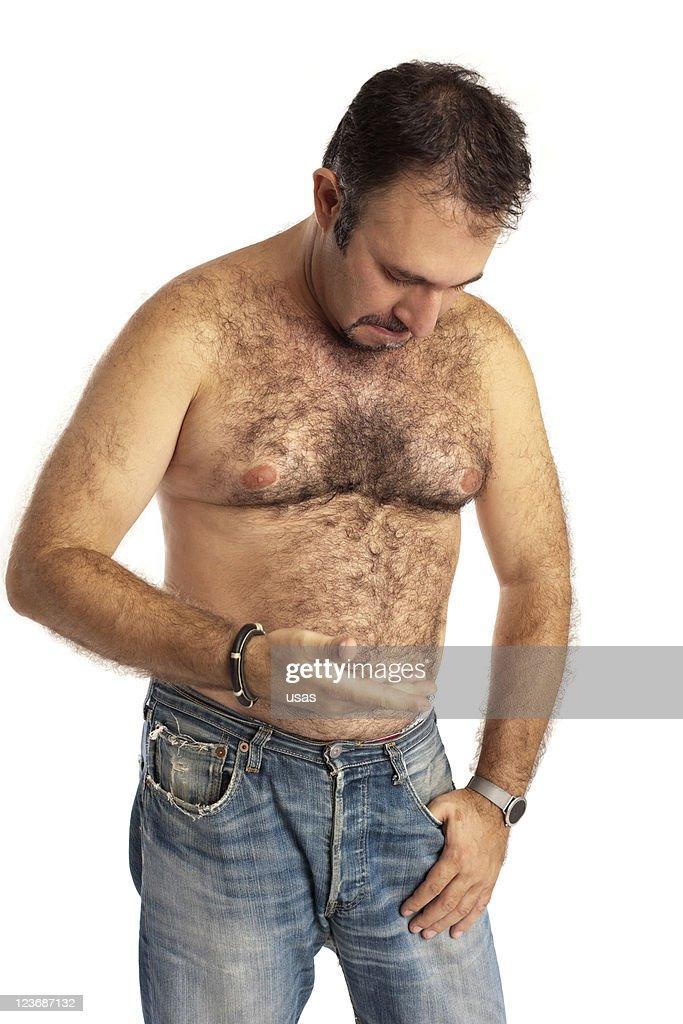 Seminude Hairy Man Looking at His Hair and Fat : Stock Photo