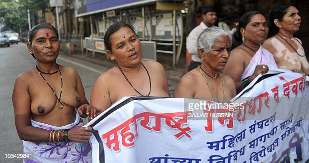 Seminude Indian Devadasi women shout antigovernment slogans during a protest in Mumbai on August 15 2010 The protest was to demand Indian Rupees 2000...