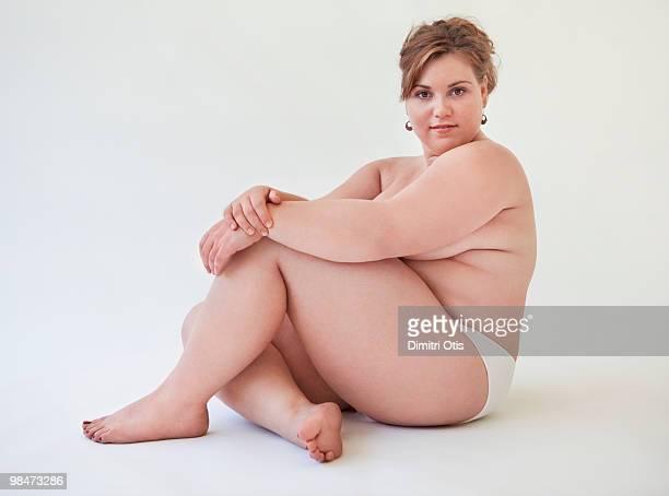 Semi-nude portrait of plus-size woman